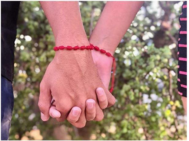 pulsera hilo rojo con 7 nudos para parejas